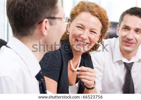Close-up portrait of red-haired lady big laughing during meeting in Hi Res with her colleagues. Happy lady communicating with her partner man about business and company. - stock photo