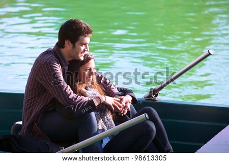 Close up portrait of romantic couple boating on river. - stock photo