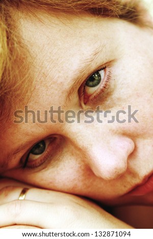 Close up portrait of sad redheaded woman