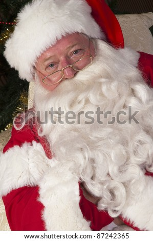Close up portrait of Santa with long white beard - stock photo