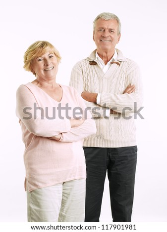 Close-up portrait of senior couple smiling against white background - stock photo