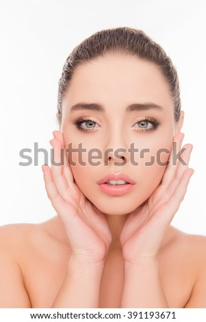 Close up portrait of sensitive beautiful girl touching her face - stock photo