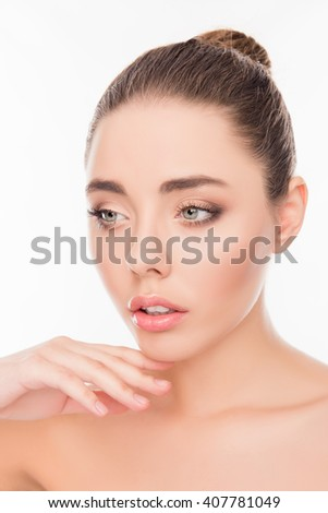 Close up portrait of sensitive young woman touching her chin - stock photo