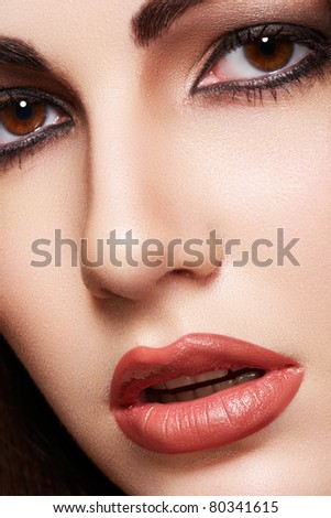 Close-up portrait of sensual arabic woman model. Beautiful clean skin, saturated makeup, bright eye make-up and dark eyeliner. Oriental style - stock photo