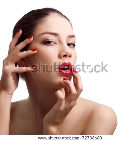 Close-up portrait of sensual caucasian young woman with red bright manicure - stock photo