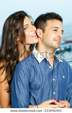 Close up portrait of sensual girl with charming smile holding boyfriend. - stock photo