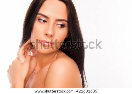 Close up portrait of sensual young woman touching her face