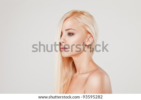 Close-up portrait of sensuality beautiful blond woman model face with fashion make-up