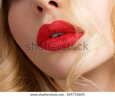 Close-up portrait of sensuality beautiful blond woman model face with fashion make-up, sexy evening red lips makeup. �osmetics and romantic retro style.  - stock photo