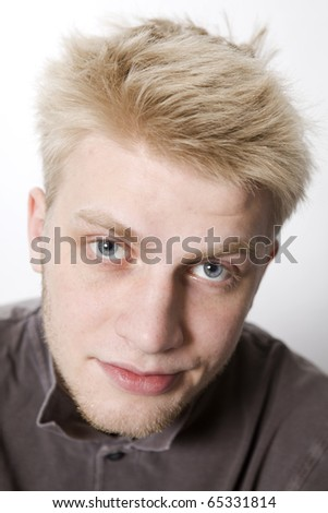close up portrait of serious blond man