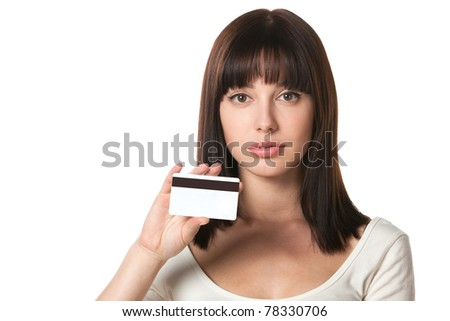 Close-up portrait of serious female holding credit card isolated on white background - stock photo