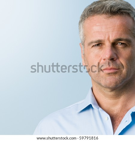 Close up portrait of serious mature businessman outdoor