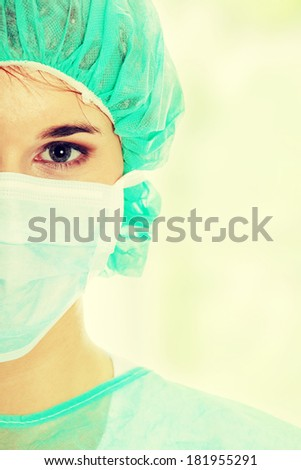 Close-up portrait of serious nurse or doctor in mask  - stock photo