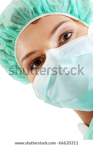 Close-up portrait of serious nurse or doctor in surgical mask - stock photo