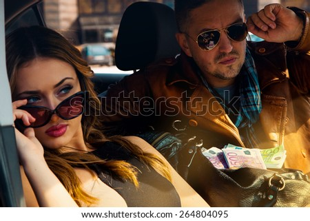 Close up portrait of sexy attractive couple in sunglasses looking away. Inside photo - stock photo