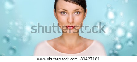 Close-up portrait of sexy caucasian young woman with beautiful eyes. Underwater background with bubbles of air and copyspace. Freshness and clean skin concept - stock photo