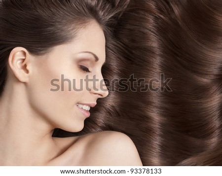 Close-up portrait of sexy caucasian young woman with beautiful hair - stock photo