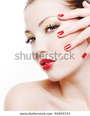 Close-up portrait of sexy caucasian young woman with golden glamour make-up and red bright manicure - stock photo