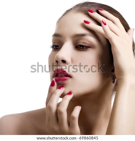 Close-up portrait of sexy caucasian young woman with red bright manicure - stock photo