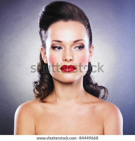 Close-up portrait of sexy caucasian young woman with retro hairstyle, beautiful eyes and sensual lips