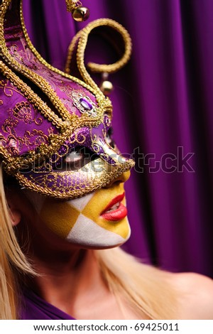 close up portrait of sexy woman in party mask - stock photo
