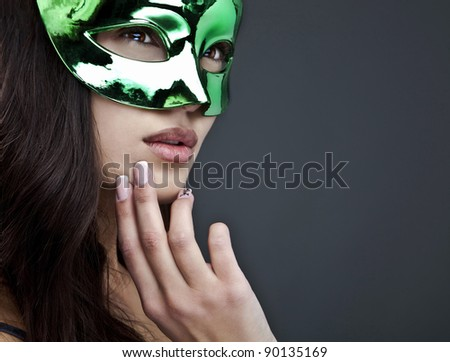 Close-up portrait of sexy woman in party mask.