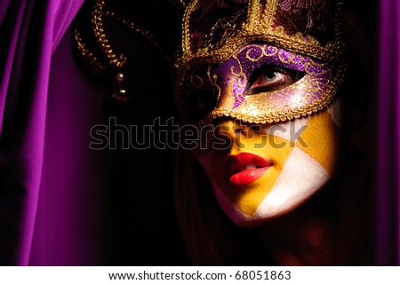 Close up portrait of sexy woman in violet party mask - stock photo