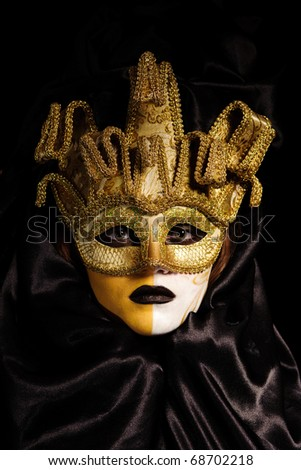 close up portrait of sexy woman in yellow party mask isolated on black