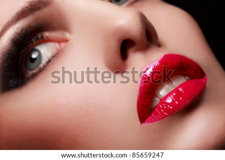 Close-up portrait of sexy young model with glamour red lips make-up - stock photo