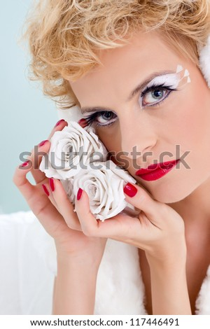 Close-up portrait of sexy young woman with  glamor make-up and red gloss manicure - stock photo