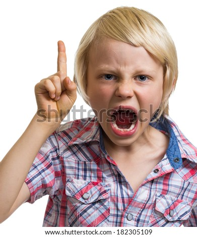 Close-up portrait of shouting angry boy with finger raised isolated on white - stock photo