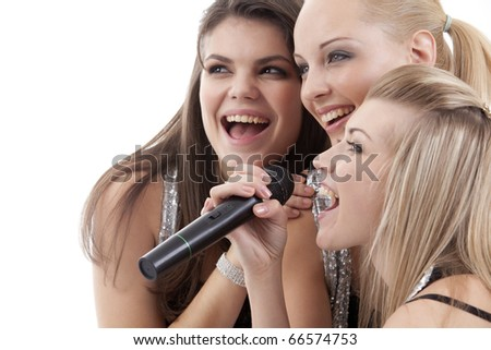 Close-up portrait of singing young women - stock photo