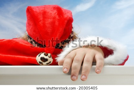 Close-up portrait of sleeping Santa Claus outdoors - stock photo