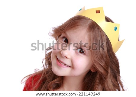 close up portrait of smiley little girl wearing paper crown/Beautiful small girl dressed as princess - stock photo