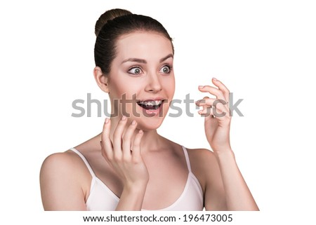 Close-up portrait of smiling caucasian young woman isolated on white background
