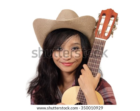 Close up portrait of smiling ethnic girl wearing cowboy hat and holding an acoustic guitar, isolated on white background - stock photo