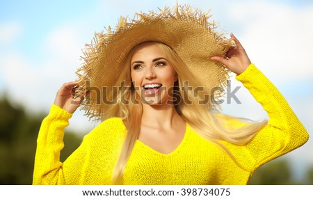 Close-up portrait of smiling female by the sea. Happy woman standing at the seaside and looking away.