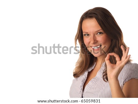 Close up portrait of smiling girl indicating ok sign (isolated) - stock photo