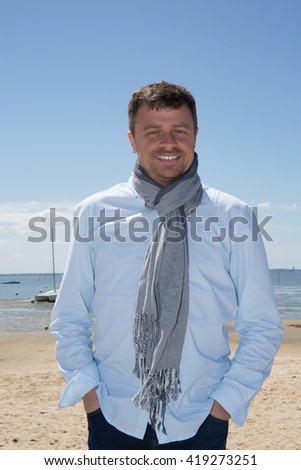 Close up Portrait of Smiling Gorgeous Handsome Man Posing at the Sea