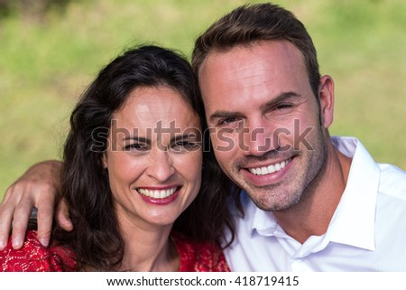 Close-up portrait of smiling happy couple - stock photo