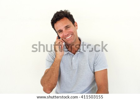 Close up portrait of smiling older man talking on cell phone - stock photo