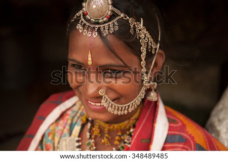 Close up portrait of smiling traditional Indian woman in sari dress, India people.