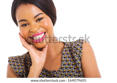 close up portrait of smiling young african woman on white background - stock photo