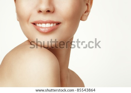 Close-up portrait of smiling young woman - stock photo