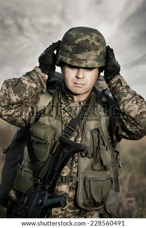 Close up portrait of soldier - stock photo