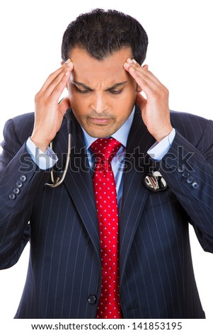 Close-up portrait of stressed male doctor - stock photo