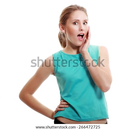 Close-up portrait of surprised beautiful girl holding her head in amazement and open-mouthed. Over white background.