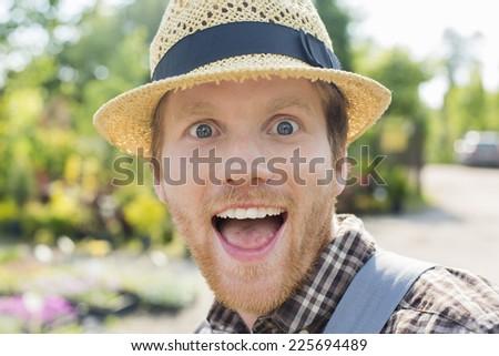 Close-up portrait of surprised gardener - stock photo