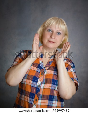 Close-up portrait of surprised middle aged woman. - stock photo