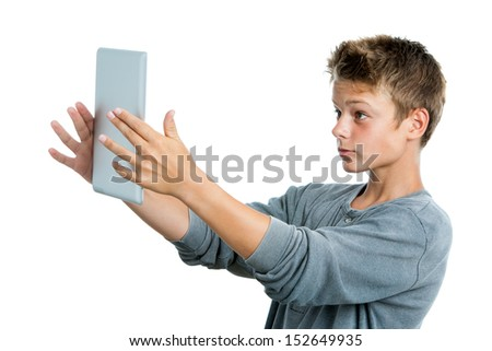 Close up portrait of teen playing game on digital tablet.Isolated on white background. - stock photo